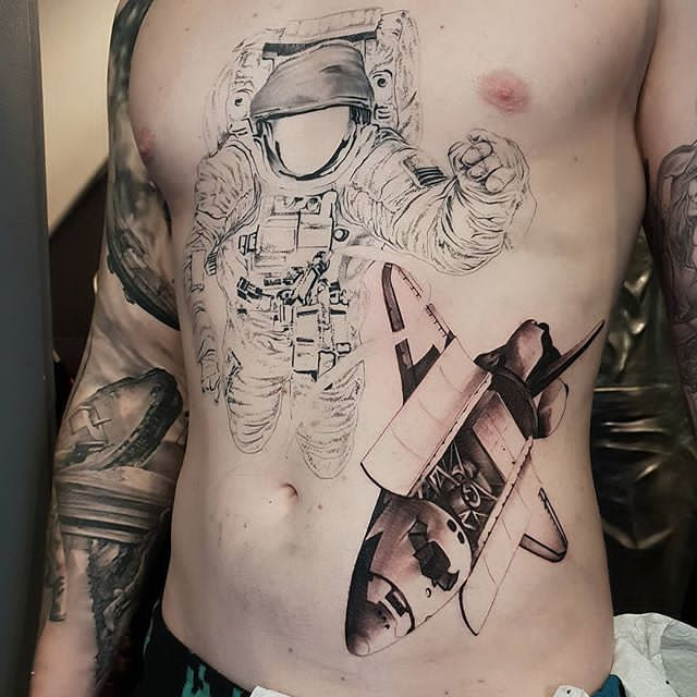 chest astronaut tattoo