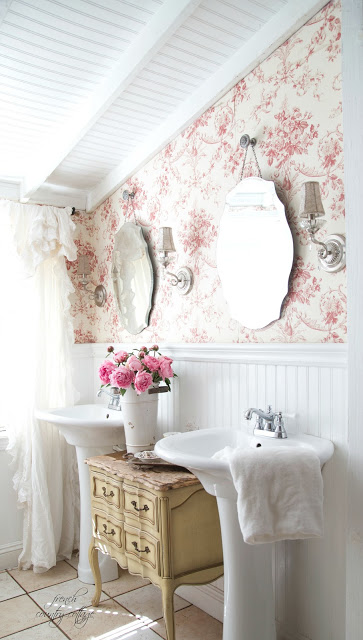 Toile wallpaper, beadboard ceiling and double sinks in french cottage bathroom