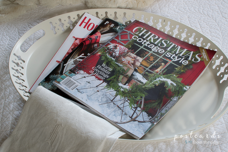 Christmas magazines on a pretty tray. Lots of other Christmas decorating ideas on this site.
