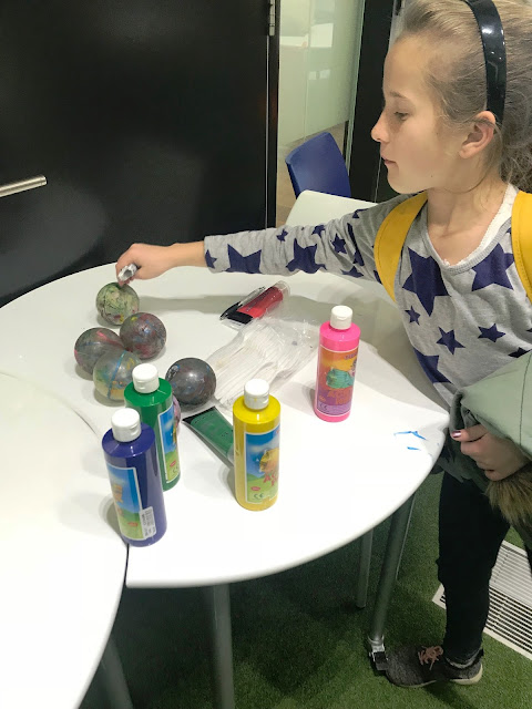 Girl showing painted Spheros