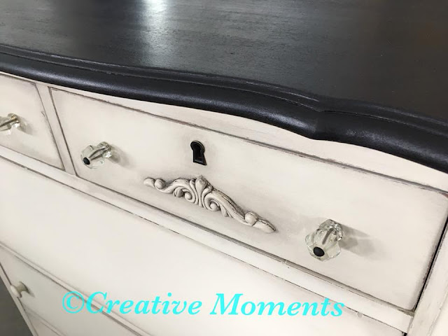 white dresser with glass knobs
