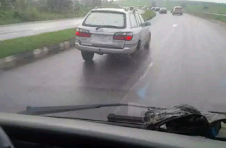 A Car On Speeding On Highway With A Missing Rear Tyre