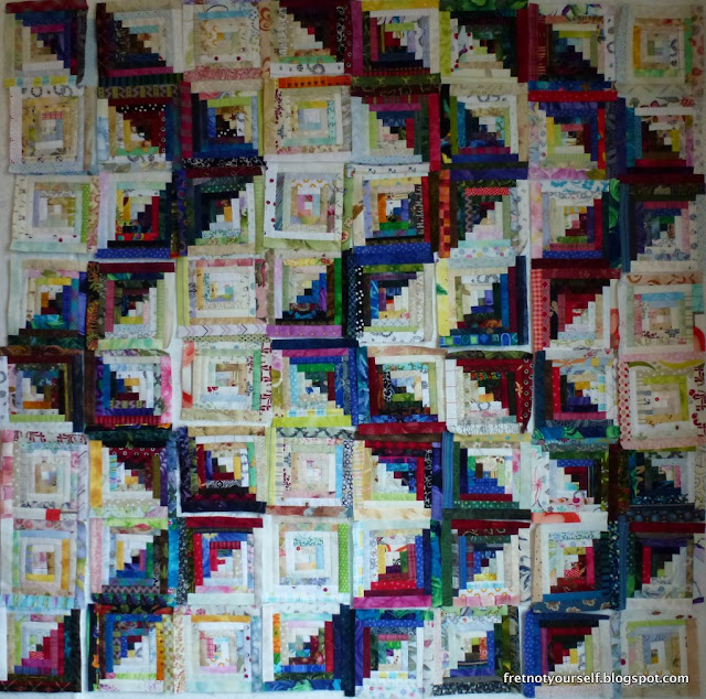 Half inch logs in lights and darks create large zig zags across this quilt.