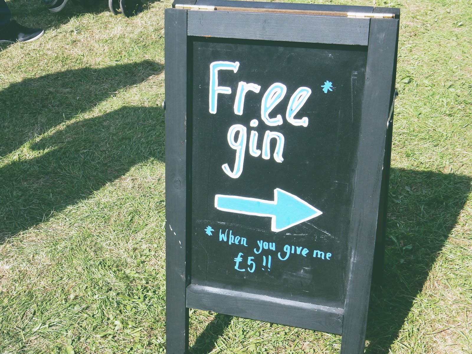 funny sign about gin at food festival