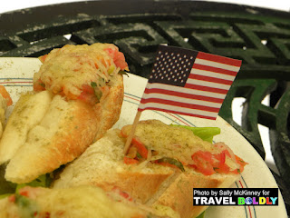 Bruschetta at La Vitrola café in Plaza Vieja  (Habana Vieja), decorated with this American flag. Cuba - TravelBoldly.com