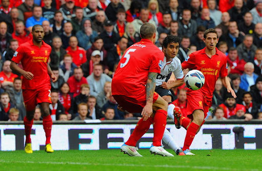 Manchester United defender Rafael shoots to score the equaliser against Liverpool