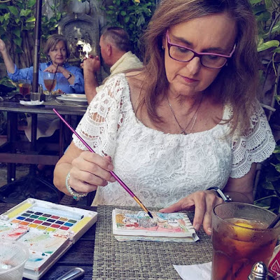Sketchbook painting in travel journal at the Goblin Market Restaurant in Mount Dora Florida by Merrill Weber The Good Life of an Artist Blog