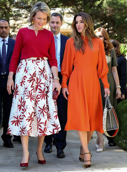 "Diane von Furstenberg Flirty Elaphe clutch, Natan dress, dress made by ""regular"" Jordanian women with local fabrics"