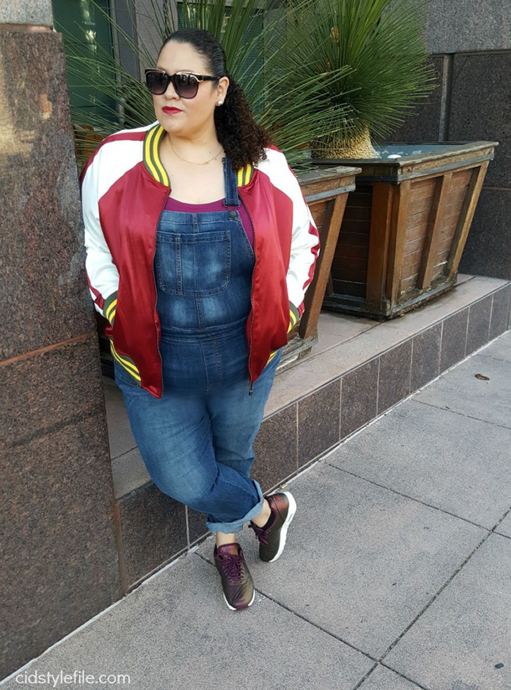 Over 40 fashion blogger Veronica of Cid Style File in a red and white bomber jacket and dungarees/overalls