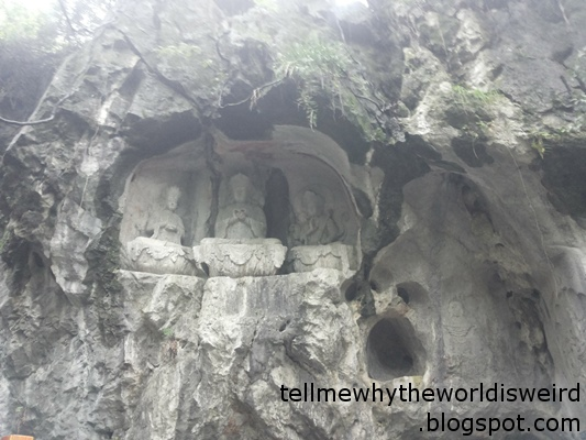 Buddhist statues carved into a rock wall