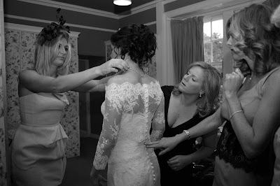Wedding party helping the bride get ready for the big wedding day in Aberdeen