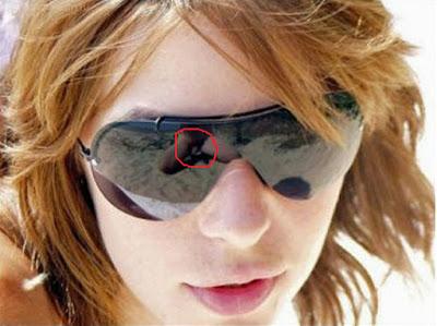 Lustige Bilder - Frau mit Sonnenbrille - peinliche Spiegelung