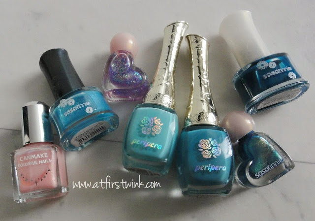 a bunch of blue nail polishes (Sasatinnie and Peripera)