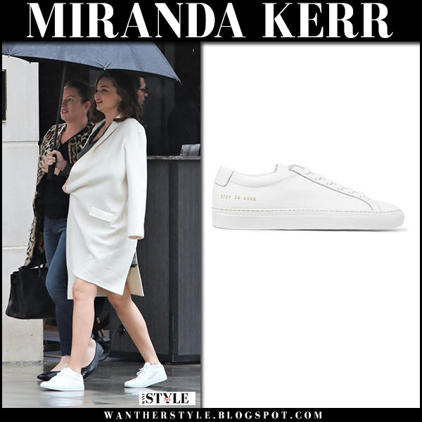 Miranda Kerr in white coat and white sneakers common projects baby bump street fashion march 3