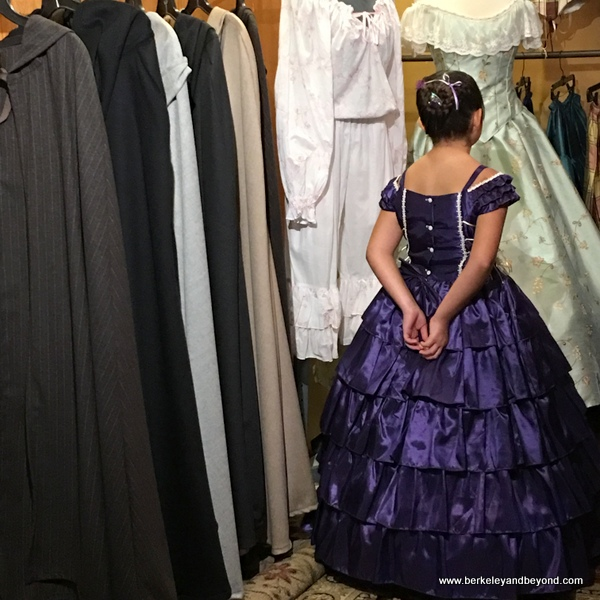 young girl in purple taffeta dress at The Great Dickens Christmas Fair in San Francisco