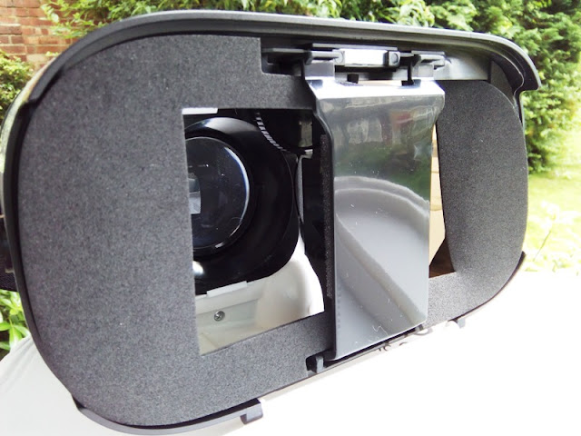 48a32c1d9af6 spherical resin lens. The magnetic front cover of the 3D virtual reality  headset flips open