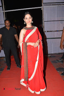 Actress Tamannaah Stills in Red Saree at Oopiri Thanks Meet 0021