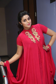 Actress Poorna Latest Stills in Red Dress at Rakshasi First Look Launch  0213.JPG