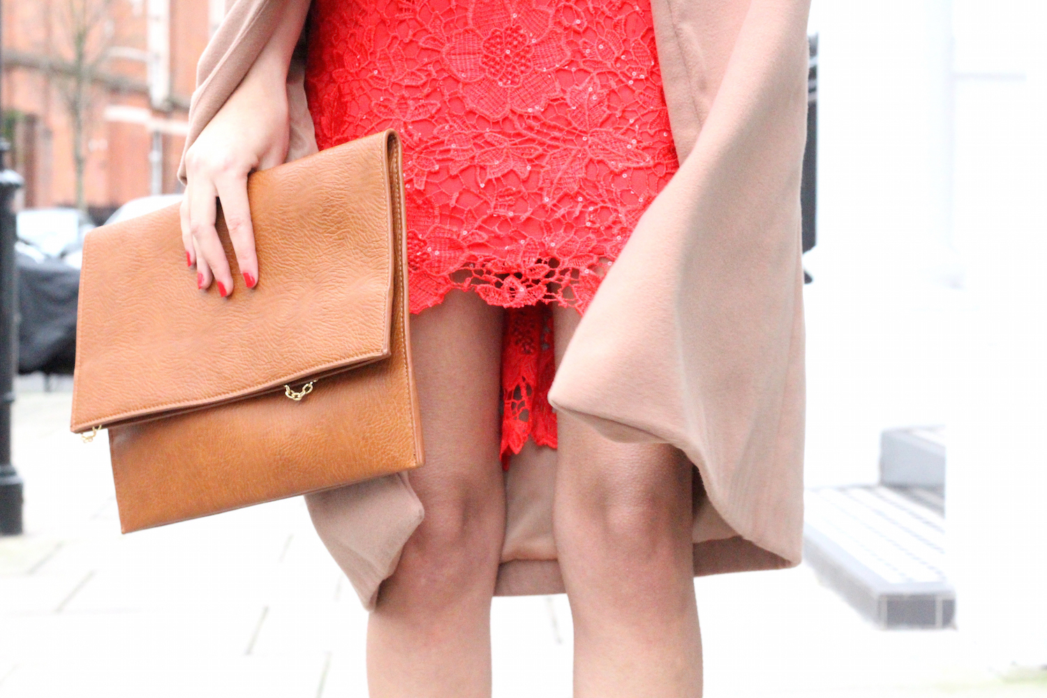 details of red quiz dress and camel worn by peexo