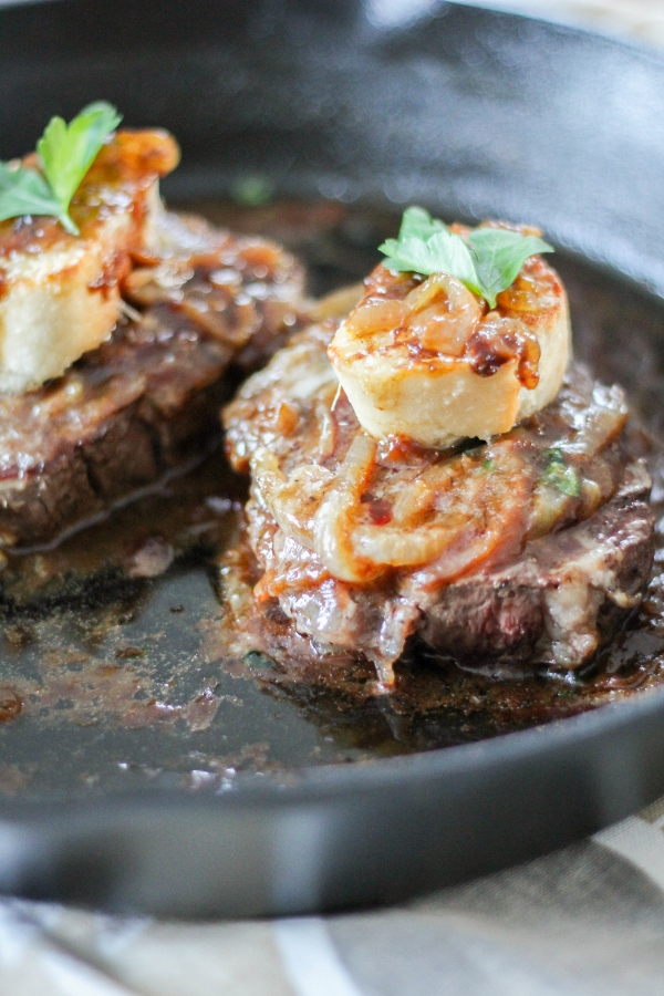 These elegant but simple French Onion Filet Mignons feature beautiful pan seared steaks topped with rich caramelized onions, a toasted baguette slice, and melty Gruyere cheese. Whether you make these for a celebration or just because, this is the perfect dinner for two!