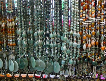 jade chains of different colors with silver