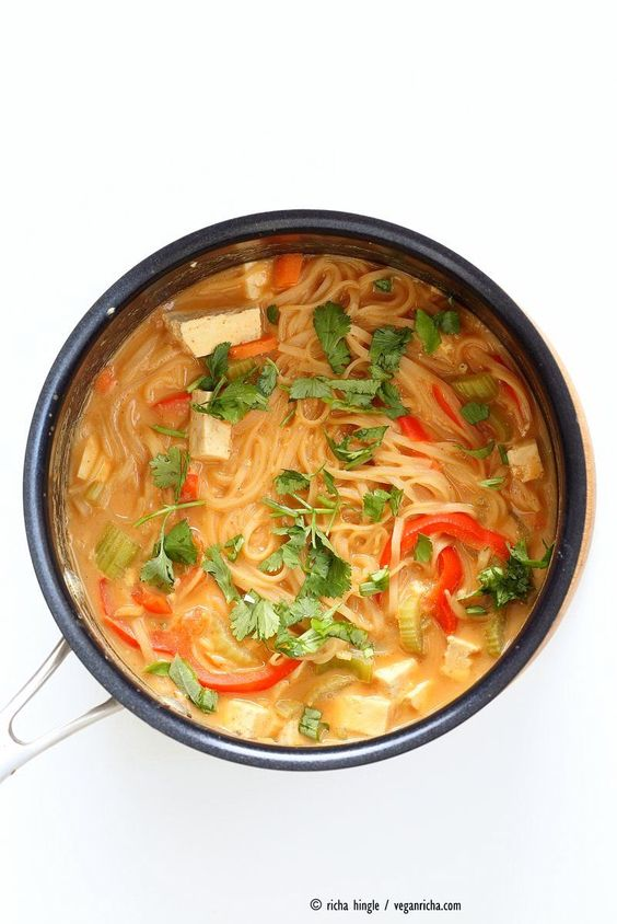 One pot peanut sauce noodles, Ready in 20 minutes! Brown Rice Noodles, Veggies, Peanut or Almond Butter, spices, flavors, boil and done. Easy #Vegan #glutenfree Quick #Weeknight #Dinner #Recipe