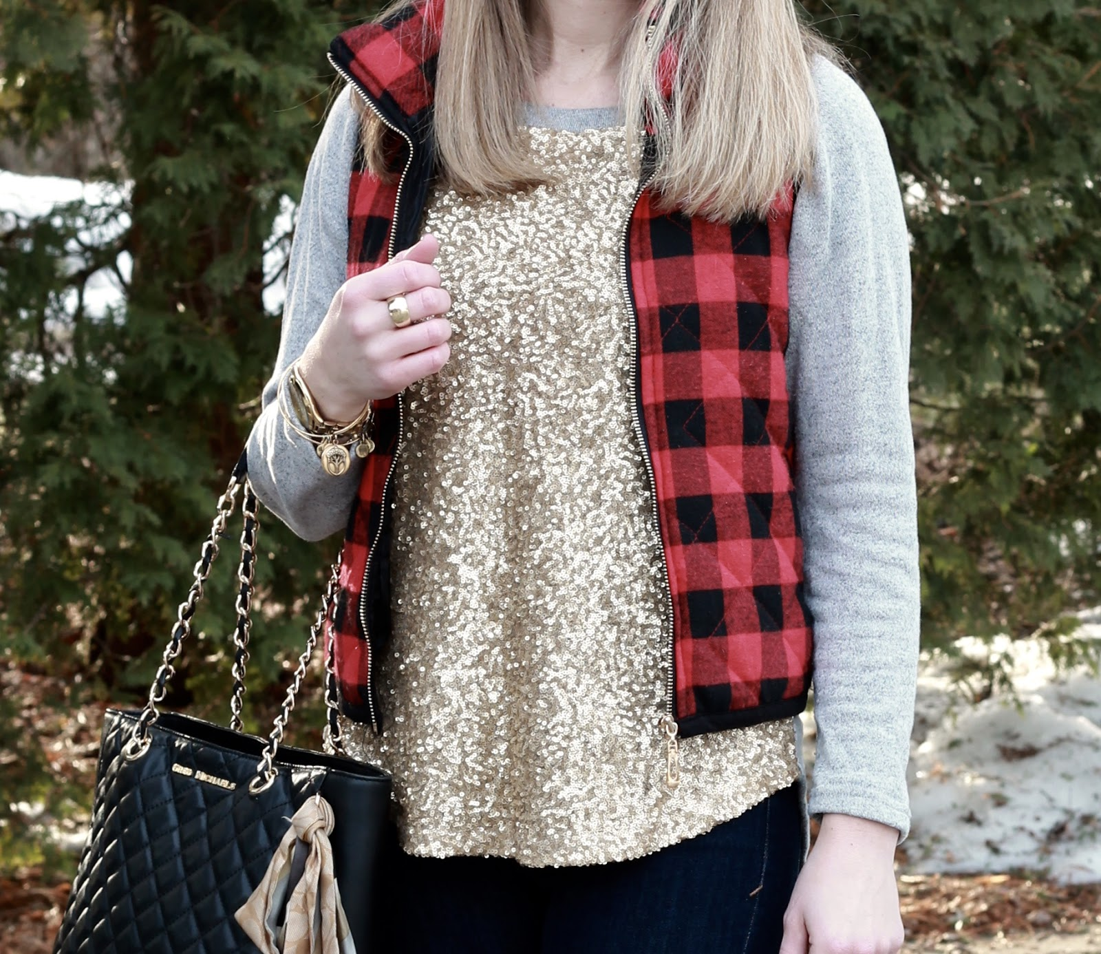 sequined grey sweatshirt, red plaid vest, Express jeans, black booties, black quilted tote,