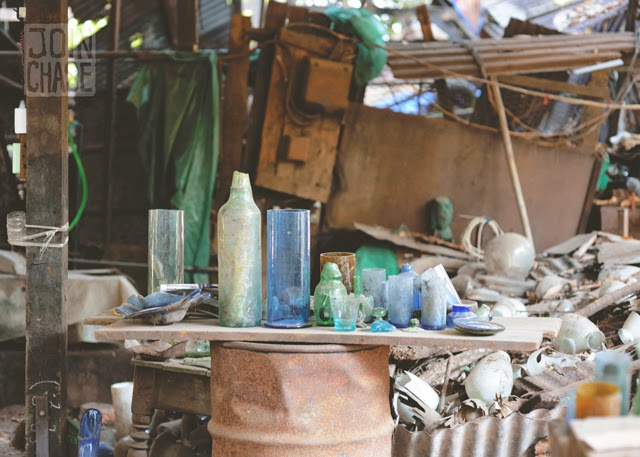 A few glass items and old pieces of what was inside Nagar Glass Factory in Yangon, Myanmar.