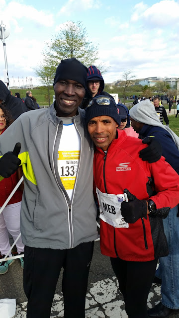 picture of Coach Wilson Komen with Meb Keflezighi