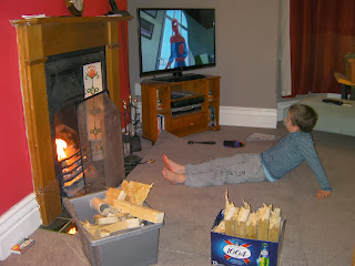 warming toes fireside with boxes of broken chopped wood
