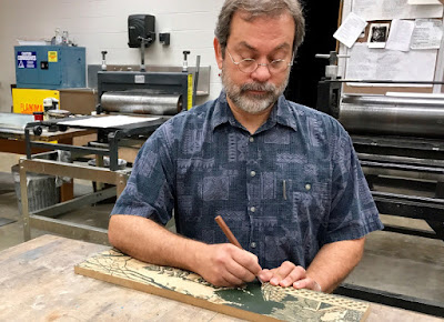Printmaker and Mosaic Artist Daniel Adams carves a printing plate in his workshop at Department of Art and Designs of Harding University, Arkansas