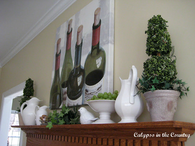 Wine Themed Mantel with greens and white for spring