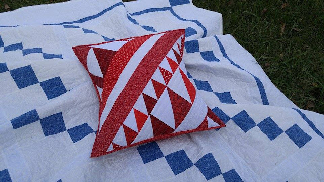 red white quilted pillow