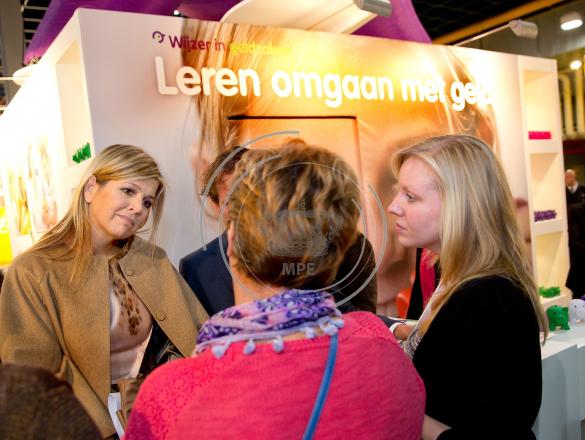 Queen Maxima of The Netherlands visits the stand Wijzer in Geldzaken during the national education fair in the Jaarbeurs in Utrecht,