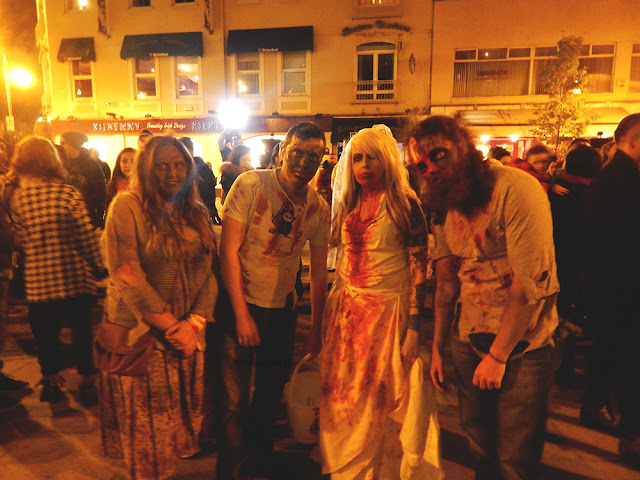 four people dressed like zombies