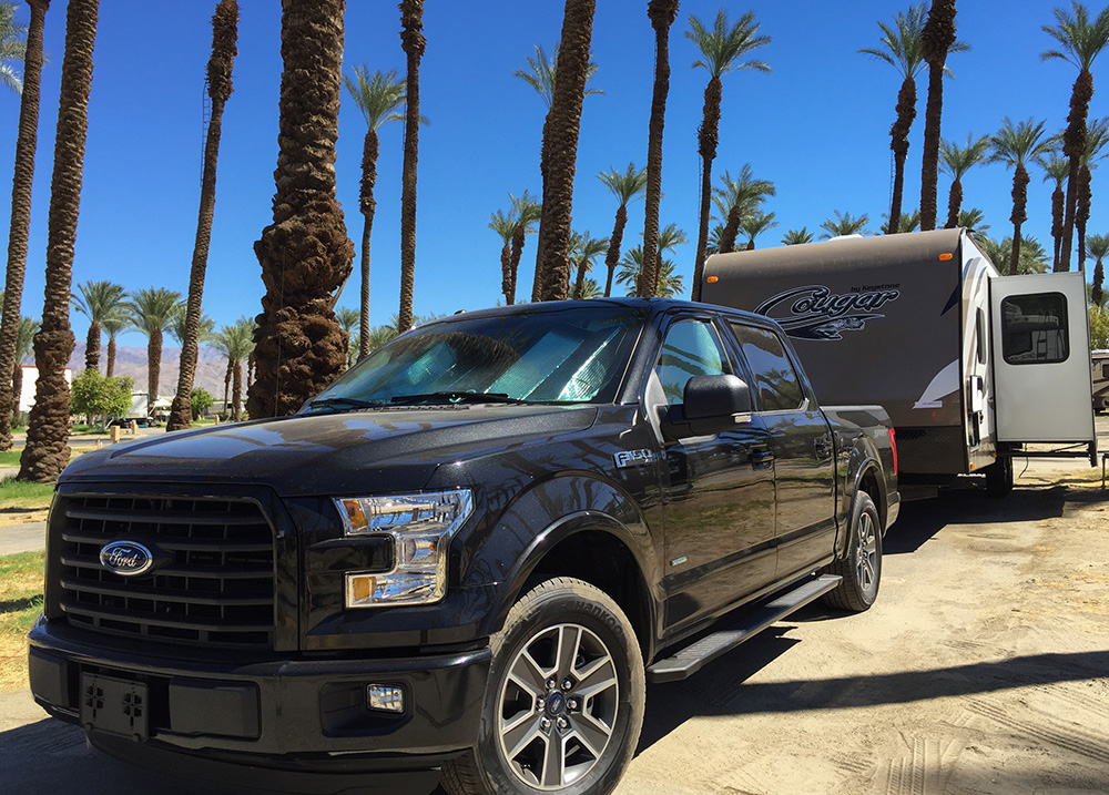 Palm Spring Ford F150 2015 truck towing RV trailer