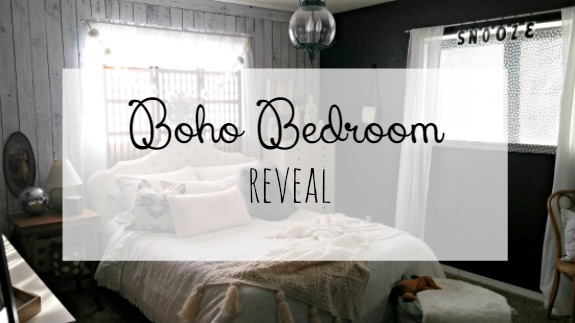 Check out this boho bedroom with black walls!