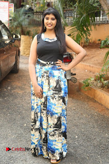 Actress Model Poorni Stills in Floral Long Dress at Silk India Expo Launch  0029.JPG