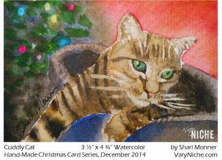 Watercolor Painting of a Grey Striped Cat lounging in front of a Christmas Tree by Shari Monner, VaryNiche.com