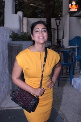 Shriya Saran in yellow miniskirt photos