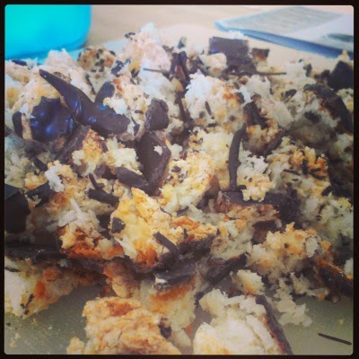 a pile of chopped macaroons, their coconutty insides and chocolate bottoms exposed for all to see.