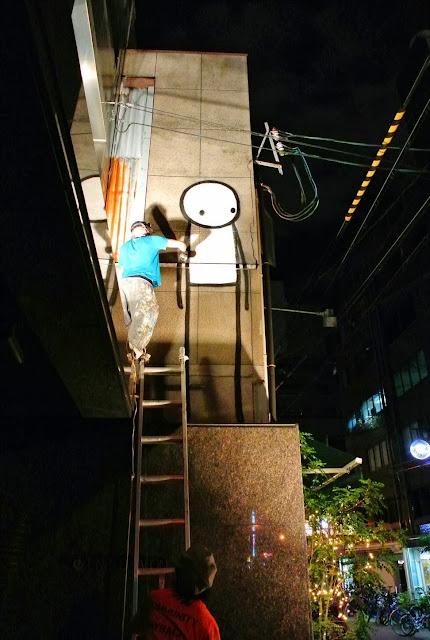 British Street Artist Stik paints a new street piece on the streets of Osaka, Japan. 3