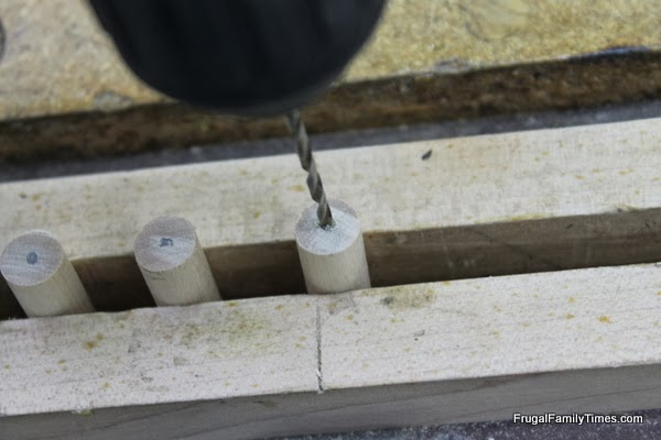drilling holes for dowels for Lego Cabinet Knobs