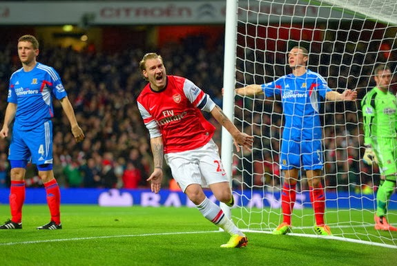 Arsenal player Nicklas Bendtner celebrates after scoring a goal against Hull
