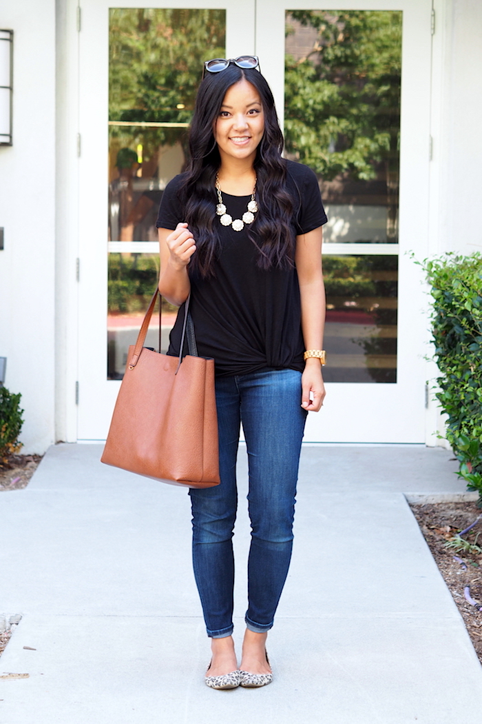 black twist tee + dark wash jeans + leopard flats + statement necklace
