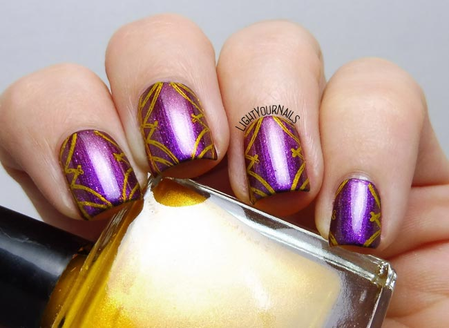 Purple and gold nail stamping