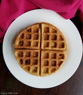 looking down on a plate with a big round waffle