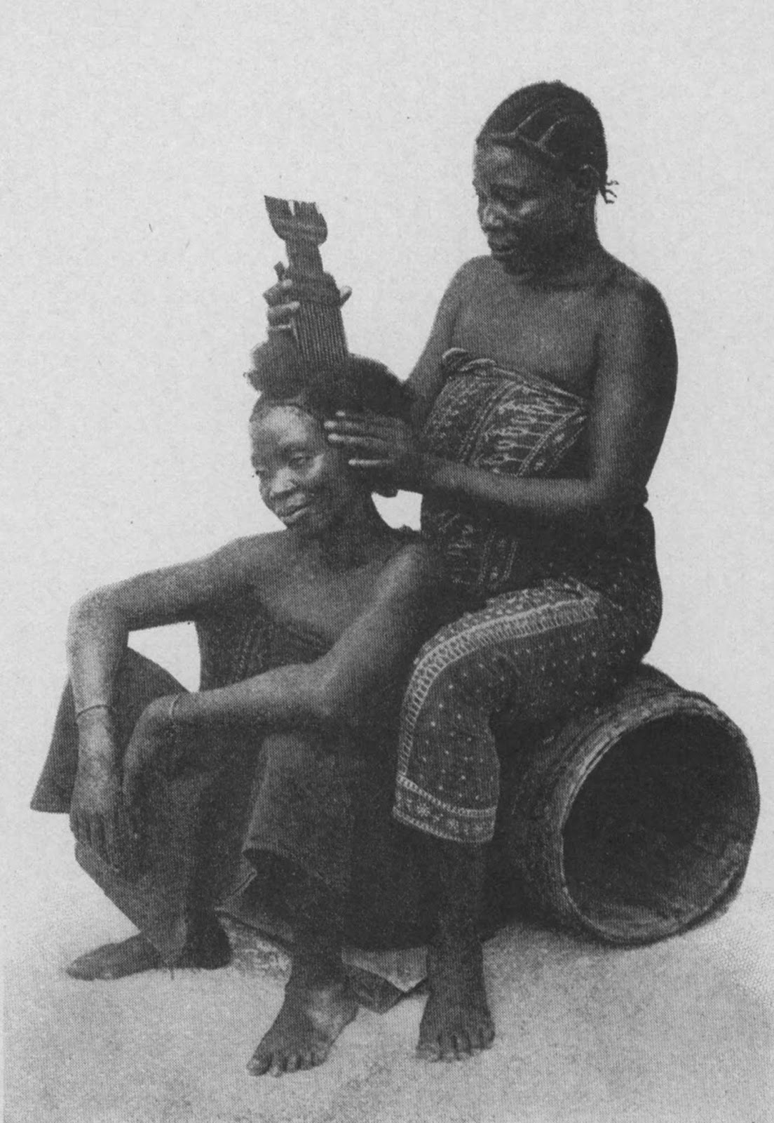 Natives dressing hair. Zanzibar, British East Africa (Tanzania), probably 1890s.