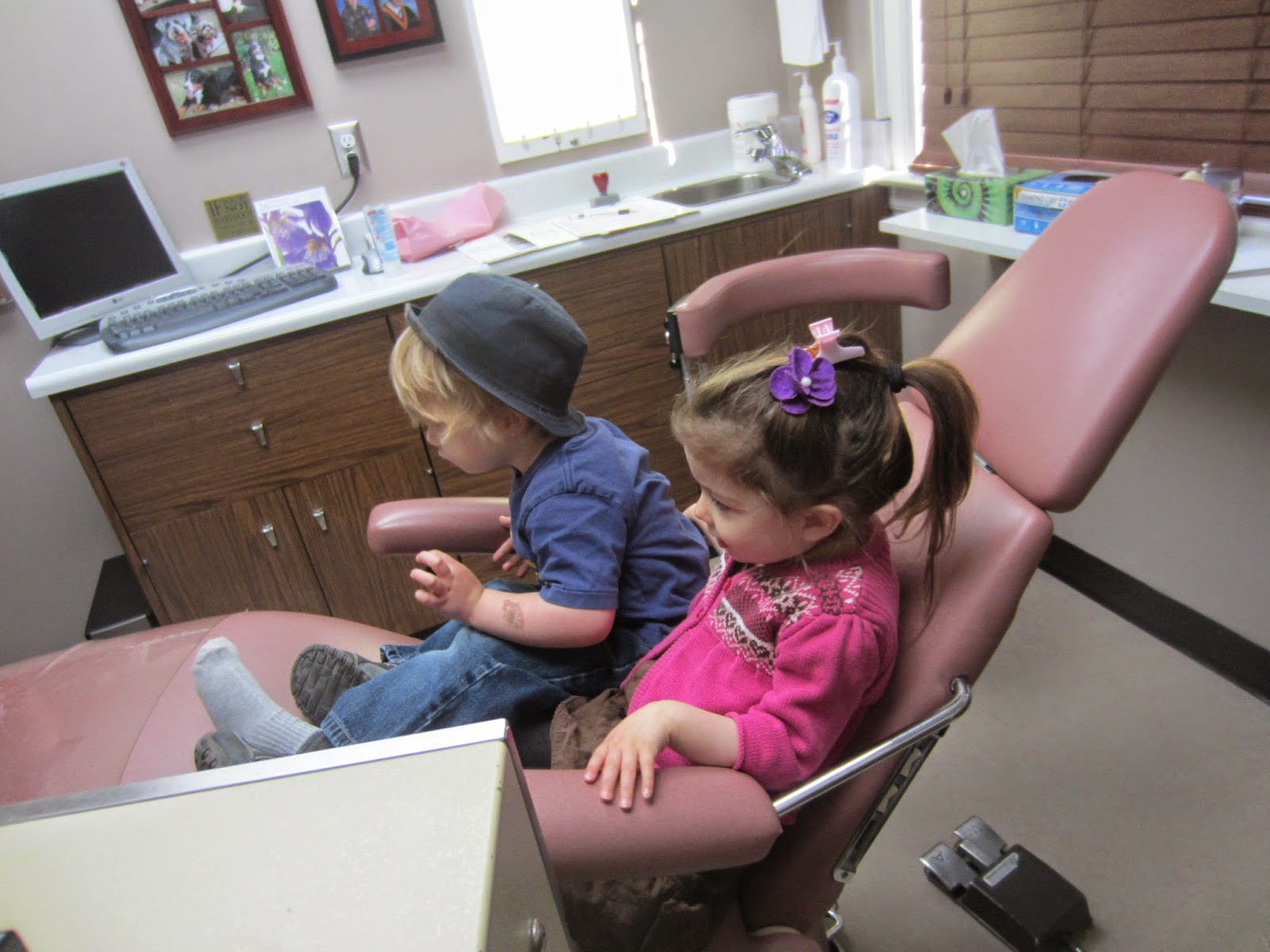 toddlers in dentist chair