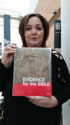 Photo of Emma Brown, October/2017, at the British Museum with one of their books called: EVIDENCE for the BIBLE.